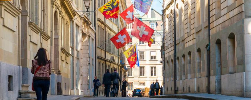 Street with swiss flags in Geneva old Town